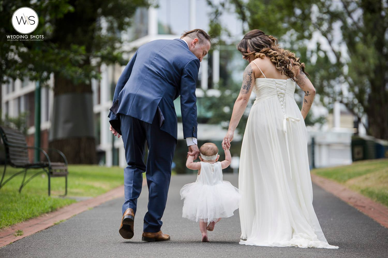 registry-couple-walking-with-child