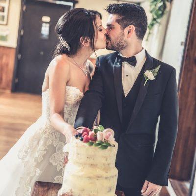 Couple cutting wedding cake at Avalon Castle