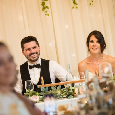 Couple laughing during speeches at Avalon Castle