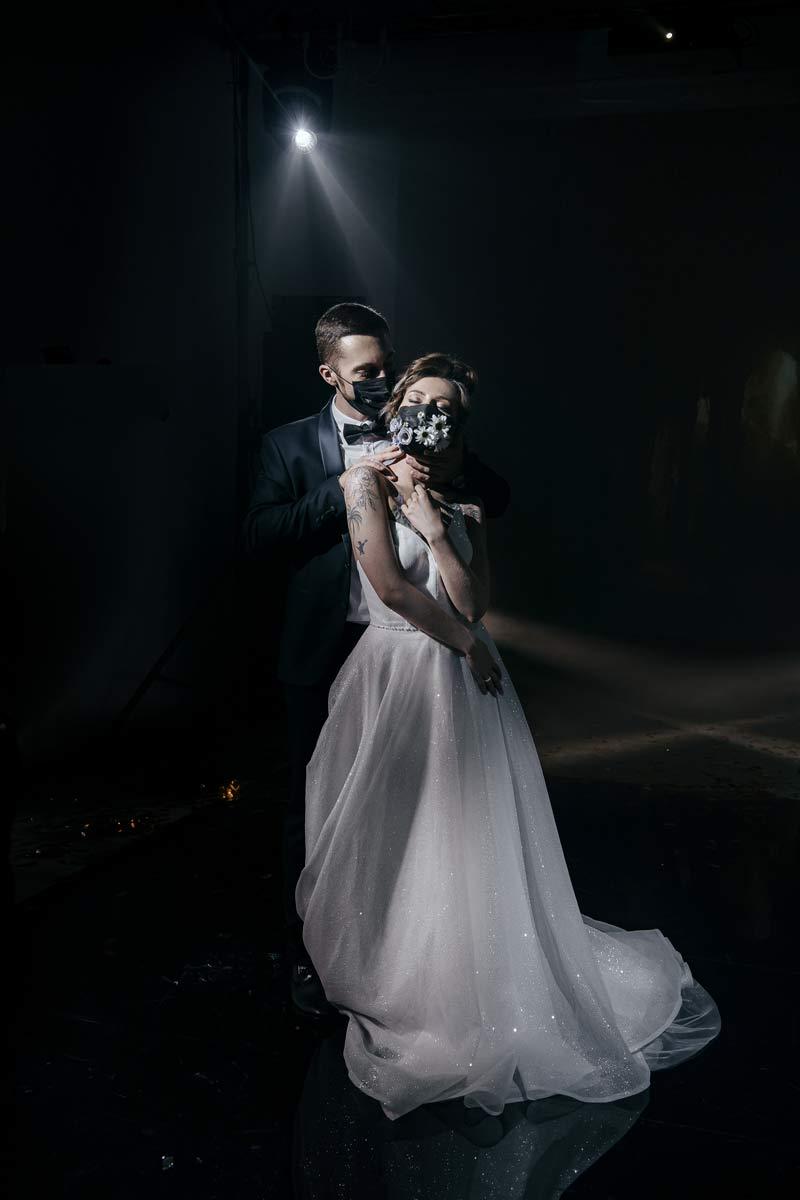 Wedding couple wearing COVID face masks